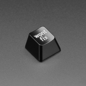 """Angled shot of black wontfix keycap.Top view of wontfix keycap.Bottom of keycap next to US quarter for scale.product video Angled shot of black wontfix keycap. Top view of wontfix keycap. Bottom of keycap next to US quarter for scale. product video DESCRIPTION It's not a bug, it's a feature! Make quick work of your Pivotals or assigned issue with a click of a button thanks to this super-classy and custom-made wont fix Etched Keycap. It's certain to spark delightful conversations about how awful you are for not acceding to every demand.  It's made with a translucent/opaque plastic that is etched to create an elegant glow-through effect. Perfect to show your decisive bug tracking management techniques, or to remind yourself that not everything in life has a solution.  Snaps onto any Cherry MX or compatible switch. It's R4 profile so will work nicely as a stand-alone key or at the top row of your keyboards.  Note: This product is a single keycap, and key switches are not included!    TECHNICAL DETAILS Single keycap dimensions:  Top: 14mm Height: 11.6mm Base: 18mm MAY WE ALSO SUGGEST… Adafruit Etched R4 Keycap for MX Compatible Switches Etched Glow-Through Keycap with Hackaday Logo Etched Glow-Through Keycap with Open Source Hardware Gear Logo Etched Glow-Through Keycap - Zener ESP Square Design Wire Whisk Style Key Cap Remover / Puller Lavender Plastic 60% / GH60 Keyboard Shell Purple Anodized Aluminum 60% / GH60 Keyboard Shell 4x4 Key Deluxe Aluminum Keypad Shell Enclosure NeoKey FeatherWing - Two Mechanical Key Switches with NeoPixels Adafruit NeoKey Trinkey - USB NeoPixel Mechanical Key Switch DISTRIBUTORS Etched Glow-Through Keycap with """"wont fix"""" Text - MX Compatible Switches"""